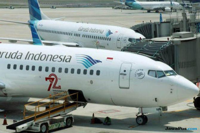 Pendapatan Garuda Indonesia Naik Tipis, Tekan Kerugian 60 Persen